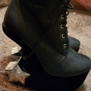 Size 7.5 gently worn black star heeled boots